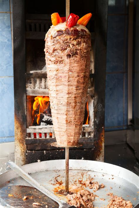 Shawarma Meat On Rotating Spit Stock Photo - Image of meat