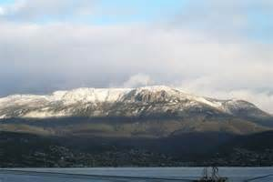 A layer of snow covers the peak of Mt Wellington - ABC
