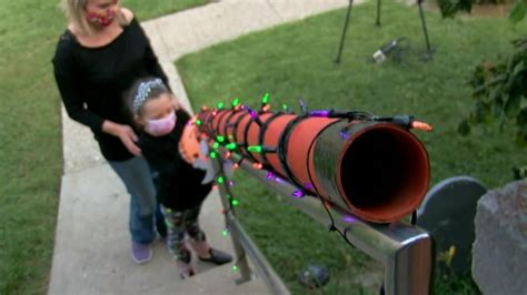 Dad creates candy chute so kids can trick-or-treat while