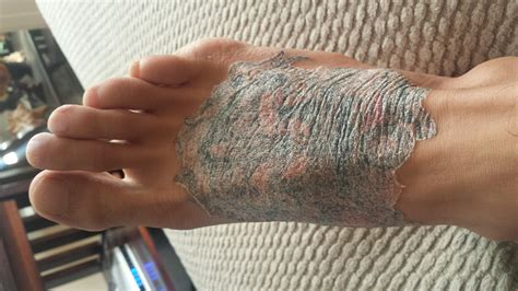 Help my foot tattoo looks screwed up nobody knows what to